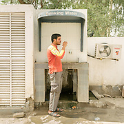 Sakir Ali is a clerk at a gas station. He often takes break to drink water.