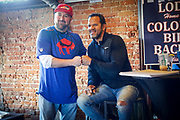 SHOT 12/10/17 1:06:22 PM - Former Buffalo Bills wide receiver and Hall of Fame player Andre Reed signs autographs and meets with fans at LoDo's Bar and Grill in Denver, Co. as the Buffalo Bills played the Indianapolis Colts that Sunday. Reed played wide receiver in the National Football League for 16 seasons, 15 with the Buffalo Bills and one with the Washington Redskins. (Photo by Marc Piscotty / © 2017)