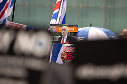 "© Licensed to London News Pictures . 16/09/2018. Manchester, UK. A placard with a photograph of Jeremy Corbyn at Cheshunt station with letters obscured by the Labour leader's head so as to read "" Cunt "" . Thousands of people including the UK's Chief Rabbi and several Members of Parliament attend a demonstration against rising anti-Semitism in British politics and society , at Cathedral Gardens in Manchester City Centre . Photo credit : Joel Goodman/LNP"