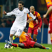 Galatasaray's Emmanuel Eboue (C) and Real Madrid's Gonzalo Higuain (L) during their UEFA Champions League Quarter-finals, Second leg match Galatasaray between Real Madrid at the TT Arena AliSamiYen Spor Kompleksi in Istanbul, Turkey on Tuesday 09 April 2013. Photo by Aykut AKICI/TURKPIX