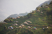 Farms and terraced fields on the steep hillsides of the Annapurna Himalaya, Nepal.