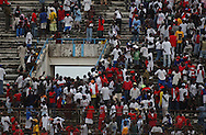 As police control the situation inside the stadium, fans flood to the exits to take their protest outside.