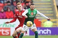 Aberdeen's David Bates (27) and Martin Boyle (10) of Hibernian battles for possession, tussles, tackles, challenges, during the Cinch Scottish Premiership match between Aberdeen and Hibernian at Pittodrie Stadium, Aberdeen, Scotland on 23 October 2021.