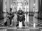 23 JANUARY 2020 - DES MOINES, IOWA: Men watch a rally in the Iowa State Capitol against factory farming. About 75 people, including farmers, environmental activists, and supporters of family farms, came to a protest in the rotunda of the state capitol in Des Moines. They are trying to pressure Iowa lawmakers to pass a moratorium against new factory farm construction in Iowa.       PHOTO BY JACK KURTZ