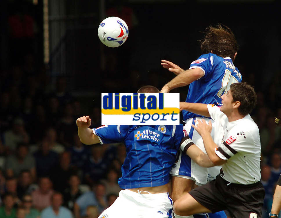 Photo: Kevin Poolman.<br />Luton Town v Leicester City. Coca Cola Championship.<br />05/08/2006. Leicester's Patrick McCarthy, Steve Robinson of Luton and Nils-Eric Johansson all go up for the ball.