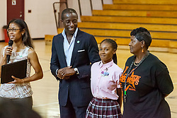 Jennifer Matthias, right, and D'Shanee Blake receive certificates for their participation in the Emerald Gems Foundation, Inc. Basketball & Education Enrichment Program conducted in Minnesota from Milt and Shalaun Newton.  Milt Newton speaks to high school students at Ivanna Eudora Kean High School sharing details about growing up in the Virgin Islands and encouraging students to have hope and focus in pursuing their dreams.  St. Thomas, VI.  27 May 2016.  © Aisha-Zakiya Boyd