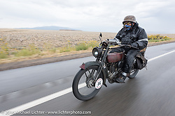Jeff Erdman of Wisconsin riding his 1916 Harley-Davidson through the rain during the Motorcycle Cannonball Race of the Century. Stage-11 ride from Durango, CO to Page, AZ. USA. Wednesday September 21, 2016. Photography ©2016 Michael Lichter.