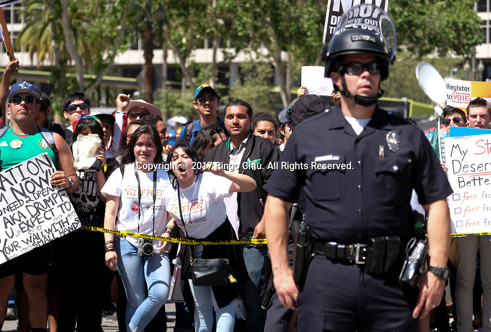 Police officers separate the May Day protesters, background, and a group of President Donald Trump supporters as they taunt each other during the annual May Day March in Los Angeles, May 1, 2017. (Photo by Ringo Chiu/PHOTOFORMULA.com)<br /> <br /> Usage Notes: This content is intended for editorial use only. For other uses, additional clearances may be required.