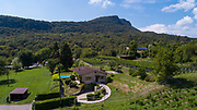 Aerial view of house with swimming pool in the countryside with hills. Copy space