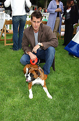 TIM VINCENT and his dog Ruby at the 3rd annual Macmillan Dog Day in aid of Macmillan Cancer Relief held at Royal Hospital Chelsea, London SW3 on 5th July 2005.<br /><br />NON EXCLUSIVE - WORLD RIGHTS