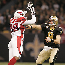 16 January 2010:  New Orleans Saints quarterback Drew Brees (9) throws past Arizona Cardinals linebacker Karlos Dansby (58) during a 45-14 win by the New Orleans Saints over the Arizona Cardinals in a 2010 NFC Divisional Playoff game at the Louisiana Superdome in New Orleans, Louisiana.