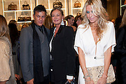 EVA CAVALLI; MELISSA ODABASH, Party to celebrate the launch of the new Cavalli Store. Roberto Cavalli. Sloane st. London. 17 September 2011. <br /> <br />  , -DO NOT ARCHIVE-© Copyright Photograph by Dafydd Jones. 248 Clapham Rd. London SW9 0PZ. Tel 0207 820 0771. www.dafjones.com.