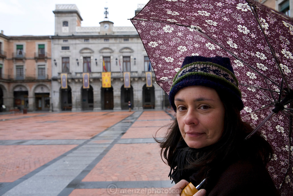 Faith D'Aluisio in the Plaza Mayor of Avila, Spain on a cold rainy morning in April. MODEL RELEASED.
