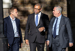 © Licensed to London News Pictures. 22/07/2019. London, UK. Grant Shapps (L), Attorney General Geoffrey Cox (R) and James Cleverly arrive for Prime Minister Theresa May's farewell drinks reception at Downing Street.  Voting in the Conservative party leadership election ends today with the results to be announced tomorrow. Photo credit: Peter Macdiarmid/LNP