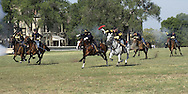 Soliders from the Commanding Generals Mounted Color Guard, in Civil War period uniforms, charge down Cavalry Parade Field following a change of command at Fort Riley, Kansas.