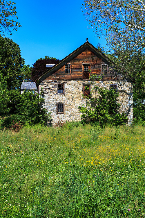 Marticville, PA, USA- May 17, 2012: An old stone house in summer in southern Lancaster County, PA.