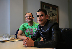 Brothers Asif Khan (left) and Aemal Khan in Hounslow, London, who were reunited when Aemal arrived from the so-called Jungle camp in Calais, France.