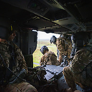 """Rescue Operations are as important a capability as patient care is to C Company 3-10 GSAB, 10th CAB.  """"Mountain DUSTOFF"""" crewchief, SPC Daniel Struxness is overseen during rescue operations training by SGT Joseph Ramsey while SGT Montgomery and CW2 Joseph Torres look on."""