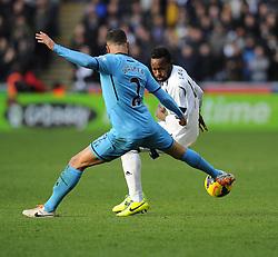 Tottenham Hotspur's Kyle Walker battles for the ball with Swansea City's Roland Lamah - Photo mandatory by-line: Joe Meredith/JMP - Tel: Mobile: 07966 386802 19/01/2014 - SPORT - FOOTBALL - Liberty Stadium - Swansea - Swansea City v Tottenham Hotspur - Barclays Premier League