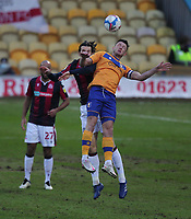 Bolton Wanderers Jordan Williams jumps with  Mansfield Town's Ollie Clarke<br /> <br /> Photographer Mick Walker/CameraSport<br /> <br /> The EFL League 2 - Mansfield Town v Bolton Wanderers  - Wednesday 17th February  2021 - One Call Stadium-Mansfield<br /> <br /> World Copyright © 2020 CameraSport. All rights reserved. 43 Linden Ave. Countesthorpe. Leicester. England. LE8 5PG - Tel: +44 (0) 116 277 4147 - admin@camerasport.com - www.camerasport.com