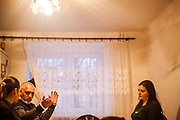 Roma activists Miroslav Klempar and Jolana Smarhovycova (right) during a meeting with volunteers and mothers with their children for consultation and data collection regarding school enrolments in Ostrava. The meeting was in a volunteers flat.