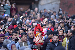 January 2, 2018 - Kathmandu, Nepal - Nepalese devotees carrying Trishna Shakya, 3yrs old Kumari or living goddess back towards Kumari Ghar or Home through destructed heritage monuments after observing the Changu Narayan festival celebrated at Hunuman Dhoka, Kathmandu, Nepal on Tuesday, January 02, 2018. (Credit Image: © Narayan Maharjan/NurPhoto via ZUMA Press)