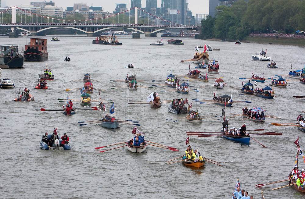 © Licensed to London News Pictures. 03/06/2012. .London, England. .The Thames river pageant. The Royal Jubilee celebrations. Great Britain is celebrating the 60th  anniversary of the countries Monarch HRH Queen Elizabeth II accession to the throne this weekend Photo credit : LNP