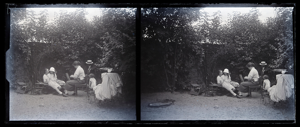 family during domestic activity in the garden 1920s France