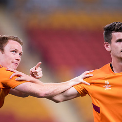 BRISBANE, AUSTRALIA - OCTOBER 13: Corey Brown and Mitchell Oxborrow of the Roar warm up during the Round 2 Hyundai A-League match between Brisbane Roar and Adelaide United on October 13, 2017 in Brisbane, Australia. (Photo by Patrick Kearney)