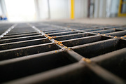 Peas are seen in the intake grates at the Puris pea protein processing facility in Dawson, Minnesota, on Tuesday, June 8, 2021.