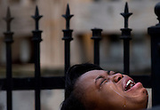Diamond Trusty cries in grief over the death of her cousin, 7-year-old Amari Brown in Chicago, Illinois, United States, July 5, 2015. Extra police patrols and long shifts were not enough to prevent nine deaths and about 50 injuries from gun violence in Chicago over the Fourth of July weekend, when homicides jump almost every year. Chicago, with 2.7 million people, is the most violent large city in the United States, with poverty, segregation, dozens of small street gangs, and a pervasive gun culture all contributing to the problem.    REUTERS/Jim Young