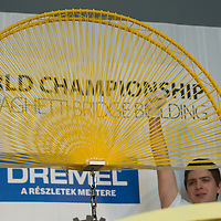 Competitor Miklos Vincze celebrates winning the Spaghetti Bridge World Championship in Budapest, Hungary on May 24, 2013. ATTILA VOLGYI