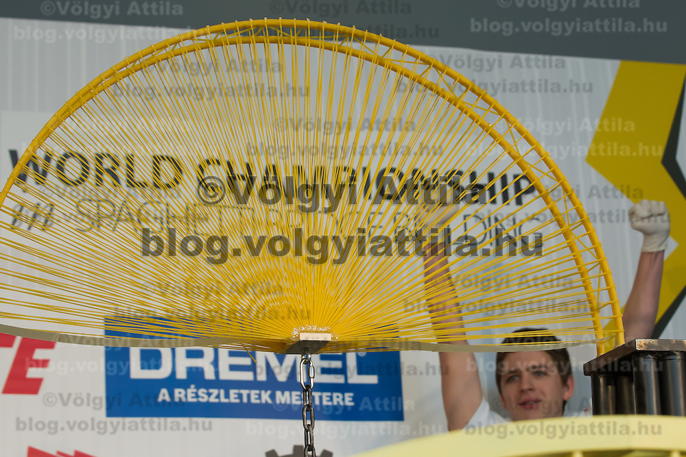 Competitor Miklos Vincze celebrates winning the Spaghetti Bridge World Championship in Budapest, Hungary on May 24, 2013. ATTILA VOLGYI