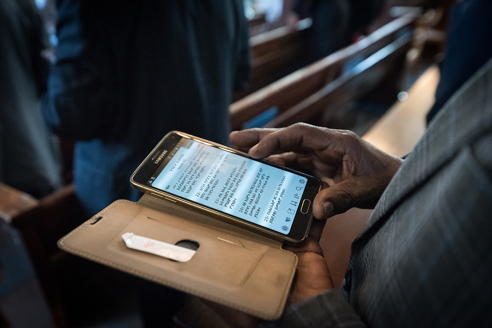 3 February 2019, Addis Ababa, Ethiopia: Congregants read the Bible on their phones, as more than 400 congregants, including a range of ecumenical guests, gather for worship at the Addis Ababa Evangelical Church Mekane Yesus, a congregation in the Ethiopian Evangelical Church Mekane Yesus. The congregation goes back to the very roots of the Lutheran presence in Ethiopia, and currently serves some 2,000 congregants, in a church of 9.3 million members spread across 9,000+ congregations around Ethiopia.