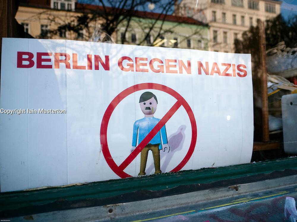 Anti Nazi sign in shop window in bohemian district of Prenzlauer Berg in Berlin Germany