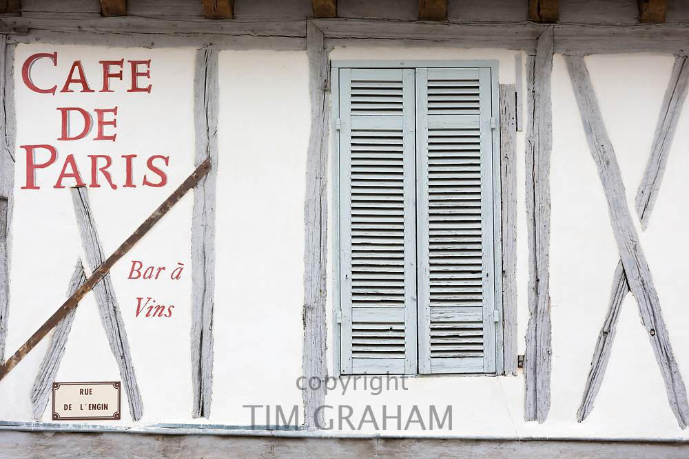 Medieval old architecture and shutters of Cafe de Paris Bar Restaurant  in 13th Century bastide town Eymet in Aquitaine, France