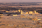 Overiew of Palmyra showing Great Colonnade and the Temple of Bel at rear, Syria at sunset from Muslim Castle.