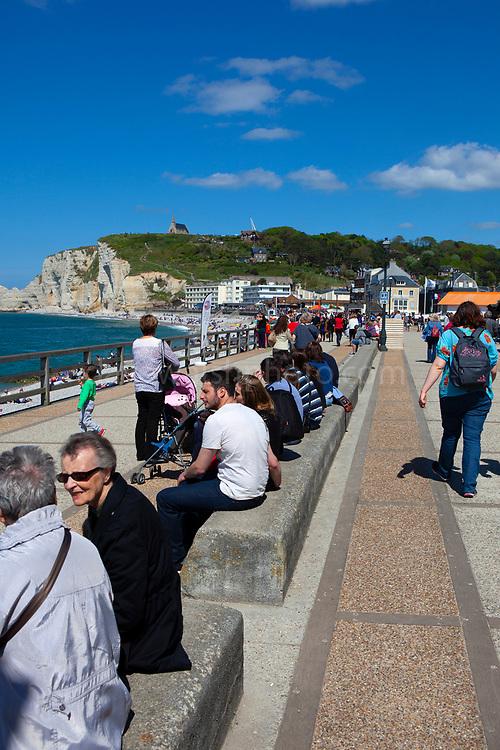 Tourists enjoying the sun in ]Etretat, Normandy, France