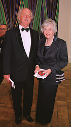 MR & MRS GARRY WESTON he is the packaging multi millionaire, at a dinner in London on 1st June 1999.MSR 74