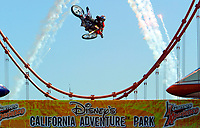 """Jul 01, 2003; Anaheim, California, USA; Moto X star athlete MIKE METZGER executing a tremendous stunt with a full sized motobike over the Park's replica of the Golden Gate Bride for the opening of Disney's California Adventure """"X Games Experience"""".  Disney park has built two X-Arena's specifically for this 41 day event highlighting extreme sports for the launch of the 2003 ESPN X Games.<br />Mandatory Credit: Photo by Shelly Castellano//Icon SMI<br />(©) Copyright 2003 by Shelly Castellano"""