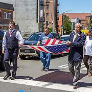 Gene DeFrancis, Earl Menard, Anthony Ferrara, and Ricardo Garcia bear the American flag.