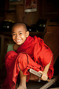 A young, novice monk in the ancient city of Ava, in Myanmar