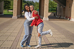 © Licensed to London News Pictures. 12/08/2021.Leeds,UK. Zoe Mutamiri and Evie Webb celebrate their GSCE results at The Grammar School at Leeds. Photo credit: Ioannis Alexopoulos/LNP