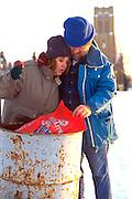 Homeless couple age 43 digging in trash.  St Paul Minnesota USA