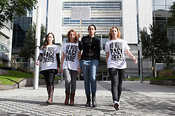 "© Licensed to London News Pictures. 13/10/2012. London, UK. Campaigners (left to right: Joanna Cheetham, Lucy Anne Holmes, Pavan Amara and Sarah Anderson) leave the News International offices in Wapping after delivering a letter to Dominic Mohan, editor of The Sun newspaper asking for an end to topless models on Page 3. An online petition started by Lucy Anne Holmes is campaigning to ""Take the bare boobs out of The Sun"". Photo credit : Vickie Flores/LNP"