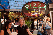 New York, NY -24 September 2011. The feast of San Gennaro in New York's Little Italy. Pizza at the restaurant Il Piccolo Bufalo during the Feast of San Gennaro.