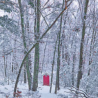 Historic outhouse behind The Little Red Schoolhouse historical landmark at the historic Longfellow's Wayside Inn Historic District in Sudbury Massachusetts covered in a snowy winter wonderland.<br /> <br /> New England country photography images of the Longfellow's Wayside Inn outhouse behind the Little Red Schoolhouse are available as museum quality photo, canvas, acrylic, wood or metal prints. Wall art prints may be framed and matted to the individual liking and interior design decoration needs:<br /> <br /> https://juergen-roth.pixels.com/featured/historic-outhouse-at-the-little-red-schoolhouse-juergen-roth.html<br /> <br /> Good light and happy photo making!<br /> <br /> My best,<br /> <br /> Juergen