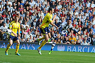 West Brom's Morgan Amalfitano ® watches as his shot at goal goes inches wide. Barclays Premier league match, West Bromwich Albion v Sunderland at the Hawthorns in West Bromwich, England on Sat 21st Sept 2013. pic by Andrew Orchard, Andrew Orchard sports photography,