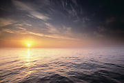Misty dawn and calm sea off the coast of Aberdeen, North Sea, Scotland