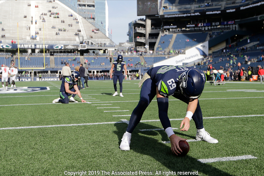 Seattle Seahawks long snapper Tyler Ott (69) snaps the ball during warmups before an NFL football game against the Tampa Bay Buccaneers, Sunday, Nov. 3, 2019, in Seattle. (AP Photo/John Froschauer)